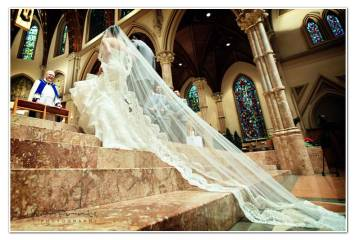 grace wore a cathedral length veil adorned with alencon lace, dramatically layered over an elegant chatilly lace