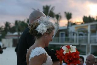 jaime wore a custom silk, feather, and crystal bloom fascinator, paired with an elegant net birdcage