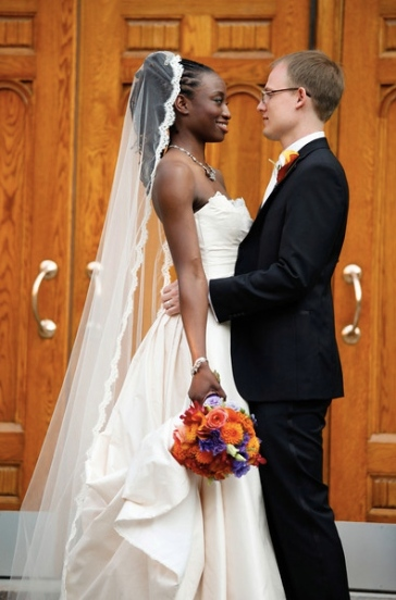 kemi wore a mantilla style cathedral length veil with elegant alencon lace detail